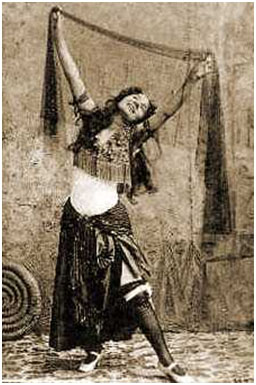 """belly dance history Belly dance history and origins: baladi means """"country"""" or """"folk"""" and refers to a particular style and costuming prior to the twentieth century, when performed, baladi was performed primarily for weddings, outdoor festivals, coffee houses and private residences."""